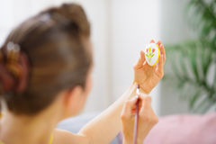 Woman painting pattern on Easter egg Stock Image