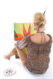 Woman painting a picture over white Stock Photos