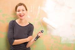 Woman painting Stock Photos