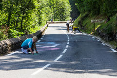 Woman Painting the Road to Col d'Aubisque. Eaux-Bonnes, France, July 15th 2011:A woman painting on the road to mountain pass Aubisque,in Pyrenees Mountains Royalty Free Stock Image