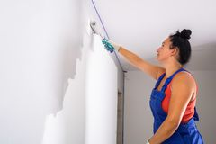 Woman painting a room royalty free stock photos