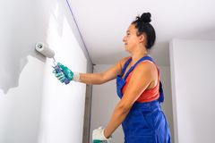 Woman painting a room royalty free stock photography