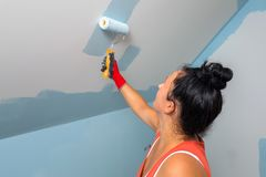 Woman painting a room stock images