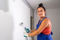 Woman painting a room stock image