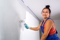 Woman painting a room stock photo