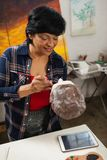 Woman painting a sculptor. In drawing class Royalty Free Stock Photography