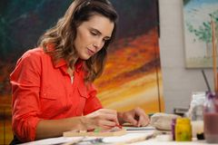 Woman painting a sketch Stock Photos