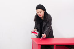 Woman painting table Royalty Free Stock Photos