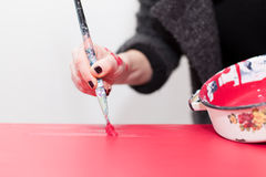 Woman painting table Stock Photography
