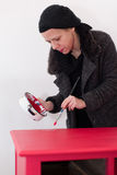 Woman painting table Stock Image