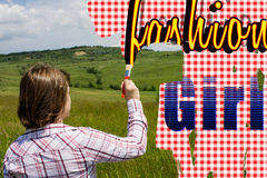 Woman painting text upon the field Stock Image