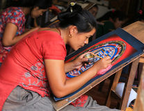 Woman painting thangka in nepal Royalty Free Stock Photo