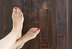 Woman painting toe nails Royalty Free Stock Photography