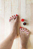 Woman painting toe nails Stock Photography