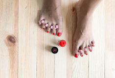 Woman painting toe nails Stock Photo