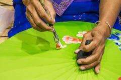 Woman painting umbrella. Royalty Free Stock Photography