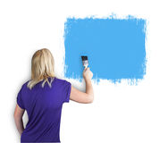 Woman painting a wall Stock Photos