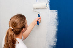 Woman painting a wall Royalty Free Stock Photo