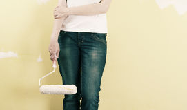 Woman painting a wall. With a roller Royalty Free Stock Image