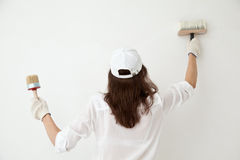 Woman painting the wall Royalty Free Stock Photography