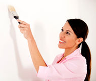Woman painting a wall Stock Image