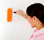 Woman painting a wall Royalty Free Stock Photography