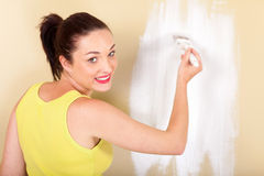 Woman painting wall Stock Photos