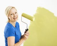Woman painting wall. Stock Image