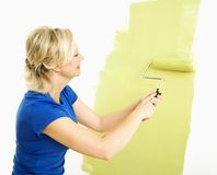 Woman painting wall. Royalty Free Stock Photography