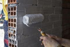 Woman painting a wall. A woman painting a wall in building works Stock Photography