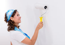 Woman painting the wall Stock Photography