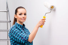 The woman painting the wall in diy concept Royalty Free Stock Image