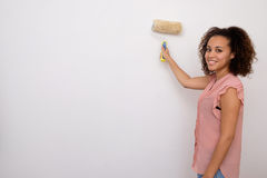 Woman painting the wall Royalty Free Stock Photo