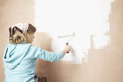Woman Painting Wall With Paint Roller Stock Photography