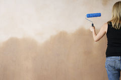 Woman Painting Wall With Paint Roller Royalty Free Stock Image