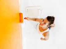 Woman Painting a Wall Stock Photography