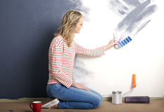 Woman painting wall Royalty Free Stock Images