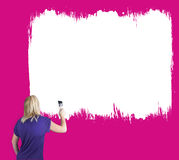 Woman painting a wall white Royalty Free Stock Image