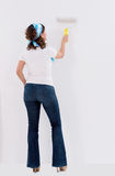 Woman painting the wall Royalty Free Stock Photos