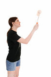 Woman painting wall. Royalty Free Stock Images