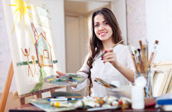 Woman paints  on canvas Royalty Free Stock Photo