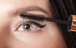 Woman paints the eyelashes mascara Stock Photo