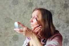 Woman paints eyelashes Royalty Free Stock Images