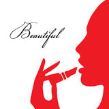 Woman paints her lips Stock Image
