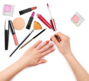 Woman paints her nails with other accessories Stock Photo