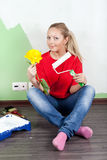 Woman paints interior wall of home Royalty Free Stock Photo