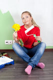 Woman paints interior wall of home Stock Image