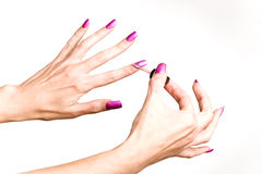 Woman paints with a varnish long nails Royalty Free Stock Photo