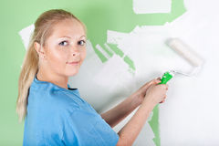 Woman paints the wall Royalty Free Stock Image