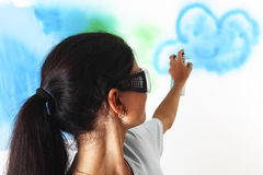Woman paints the wall Royalty Free Stock Images